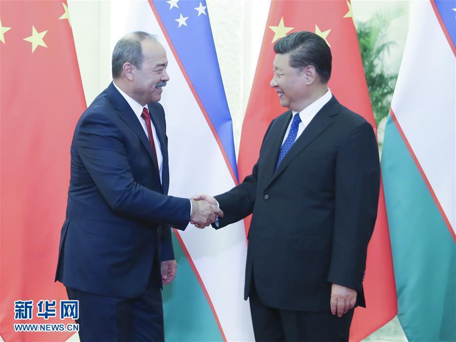 (时政)习近平会见乌兹别克斯坦总理阿里波夫